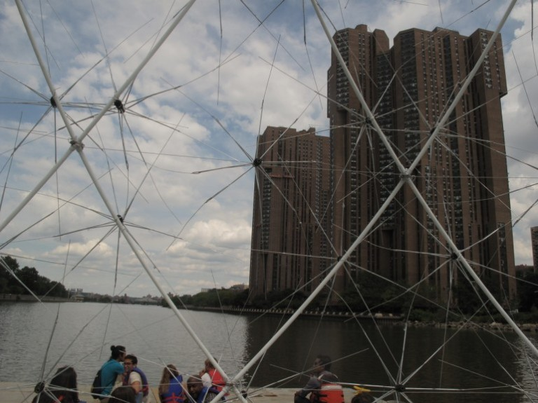 Dome of broken umbrellas takes to New York river - Images